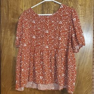Rust colored baby doll top plus size